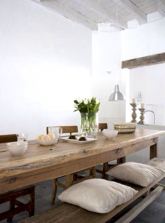 a rustic dining table is long and can accommodate a lot of guests, a long bench will let them all sit comfortably