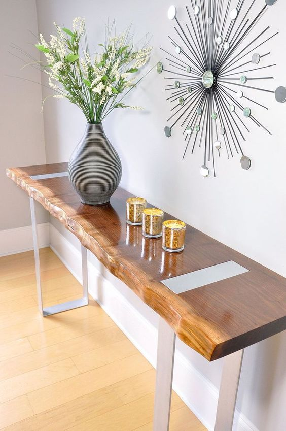 a sleek entryway console with a live edge and contrasting metal legs for a chic and one-of-a-kind look
