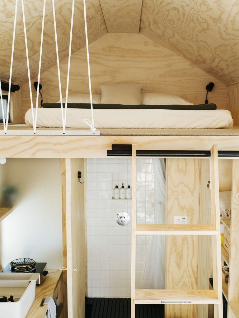The sleeping area is upstairs and can be accessed via a wooden ladder that slides into place