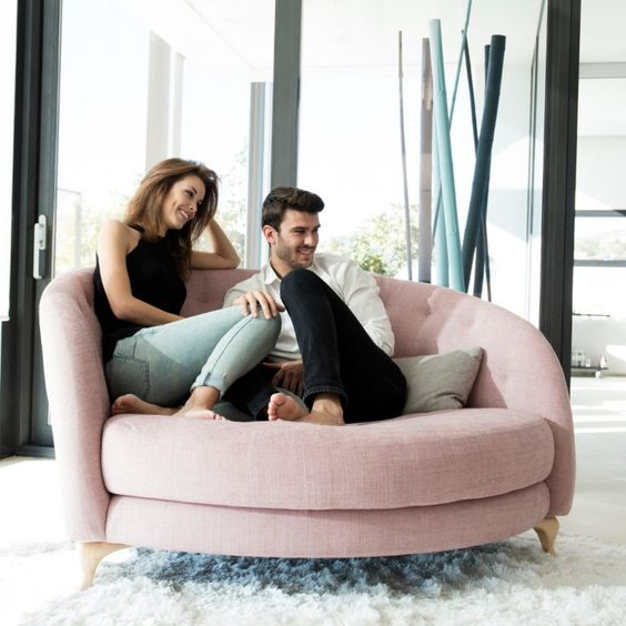 a rounded pink loveseat with tufted upholstery is a cute and attractive idea for any of your spaces