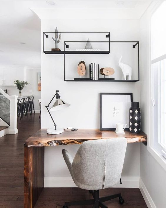 a small wall-mounted live edge wooden desk placed in an awkward corner is a genius idea with an edgy touch