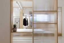13 a wood and frosted glass room divider with plenty of storage doesn't look bulky and provides storage