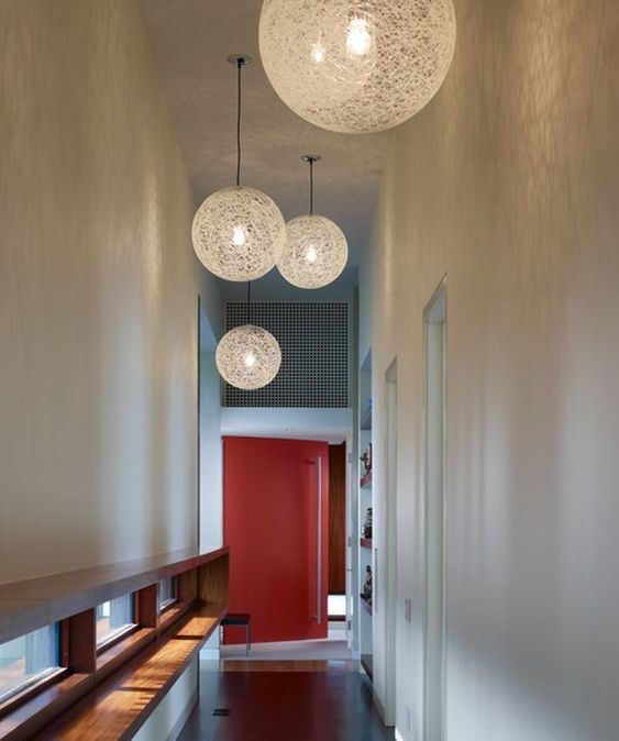 contemporary woven pendant lamps finish off the space and bring enough light to the hallway
