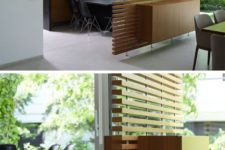 14 a contemporary slatted wood room divider with a cabinet integrated for storage is sheer enough for a small space