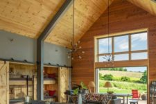 15 a contemporary and sleek barndominium space with a supporting metal construction and wood all around