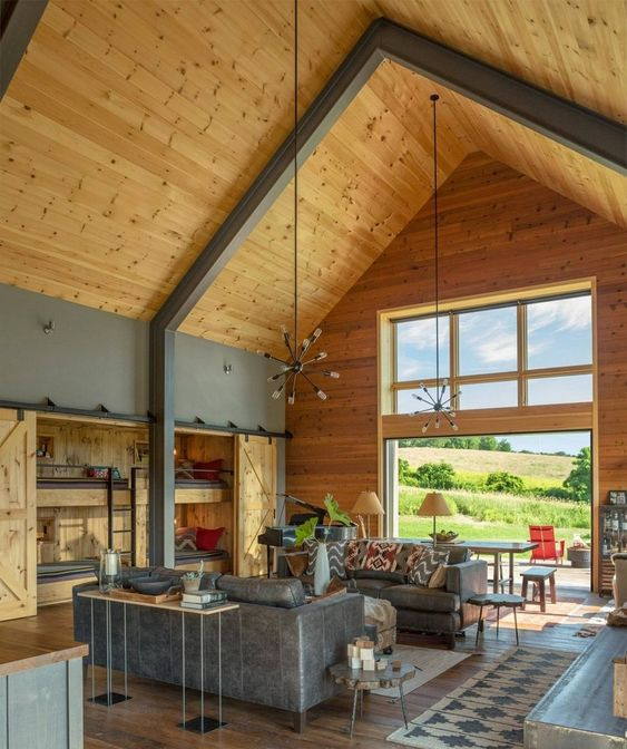 a contemporary and sleek barndominium space with a supporting metal construction and wood all around
