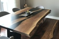 15 a sleek wooden dining table with black touches and a live edge plus a matching bench for a contemporary feel