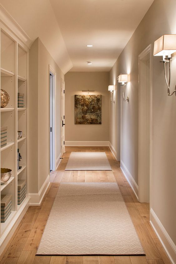 contemporary wall sconces and some built-in lights create a cozy and soothing ambience