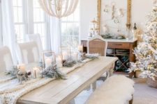 16 a whitewashed wood dining table and vintage chairs and a bench create a sophisticated dining space