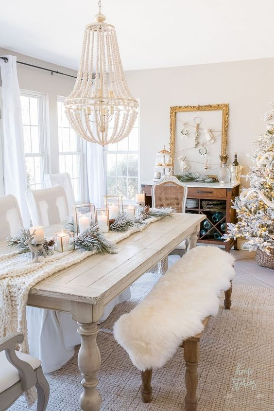 a whitewashed wood dining table and vintage chairs and a bench create a sophisticated dining space