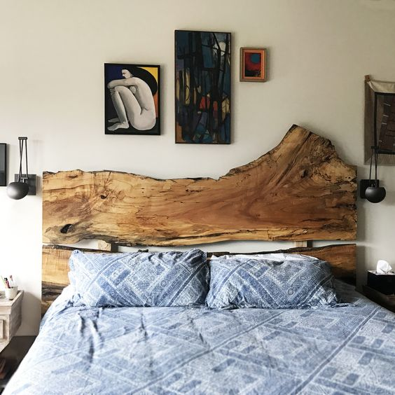 a bed with a statement live edge headboard, which brings a natural feel and makes the bedroom a bit boho