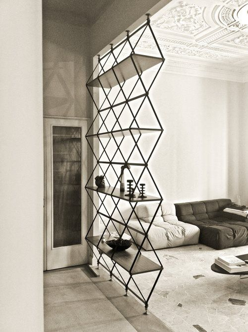 a contemporary room divider of metal and wood is a stylish idea with a touch of pattern
