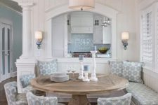 17 a rustic round table and patterned chairs and a bench for a cozy rustic dining space with a beachy feel