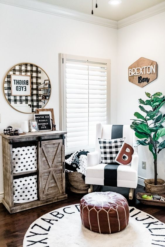 a super bright and cozy farmhouse nursery with a name sign of plywood in the corner is a cool idea