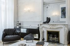 17 sophisticated molding on the walls, ceiling and fireplace make the contemporary black and white furniture more balanced