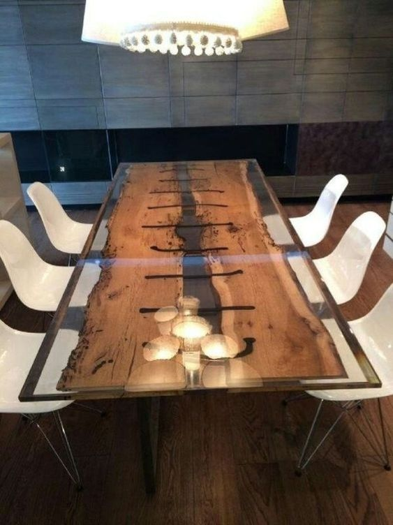 a contemporary dining table with antique wooden planks integrated into resin for a fresh look