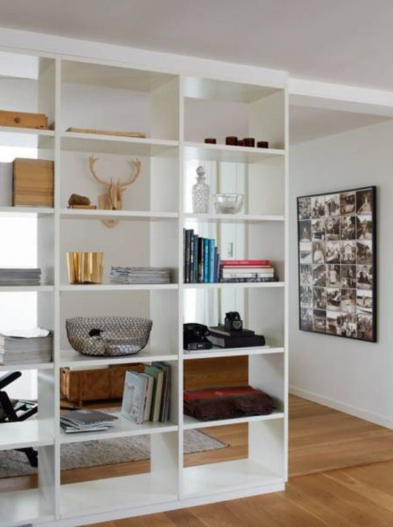 a large open shelving unit from ceiling to floor is a cool idea to separate spaces with functionality