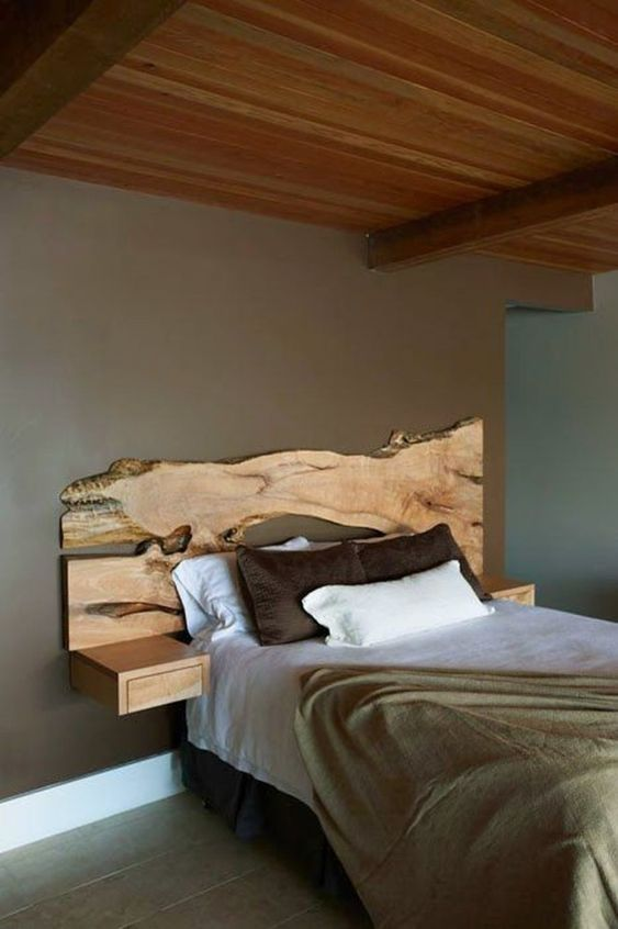 a live edge headboard makes a statement and sleek wall-mounted nightstands seem to continue the piece