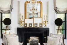 19 a refined gold and crystal chandelier and a gold framed mirror that matches for a chic touch