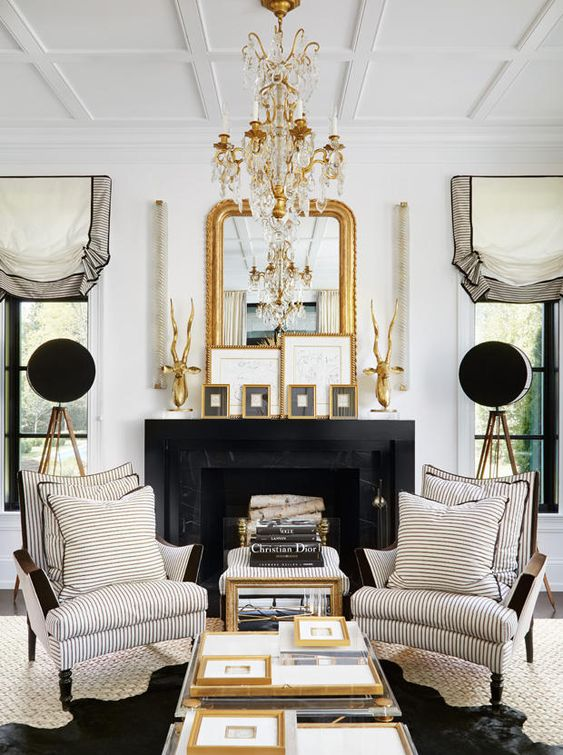 a refined gold and crystal chandelier and a gold framed mirror that matches for a chic touch