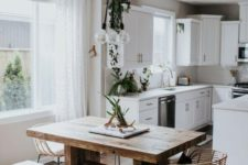 19 a simple wooden dining table with a minimalist design and a matching bench make the space modern yet rustic
