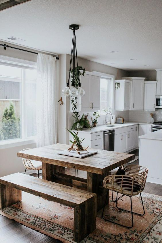 a simple wooden dining table with a minimalist design and a matching bench make the space modern yet rustic