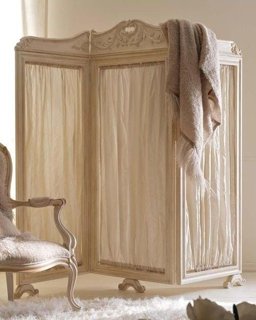 a vintage wooden screen with neutral fabric will make a chic statement in your home