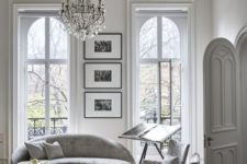 20 a white Parisian living room with a chic and sophisticated crystal chandelier that adds to the style