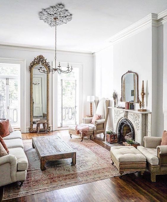 a chic ornate fireplace is a statement feature in the room and it makes the space cooler and bolder