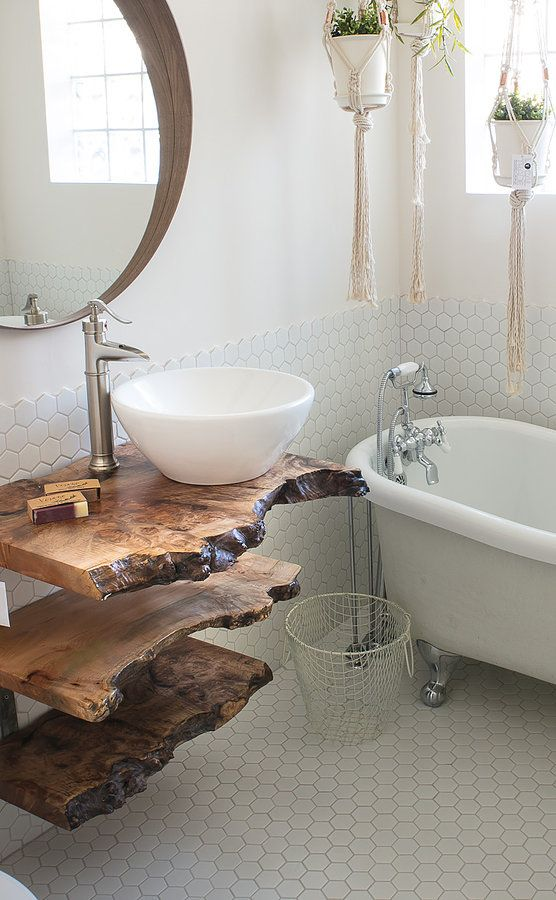 a live edge vanity made of three separate shelves makes a statement in the neutral space and adds color and texture