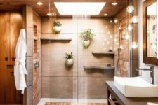 22 a warm-colored spa-like shower space done in neutrals and with a rain shower and lights for relaxation