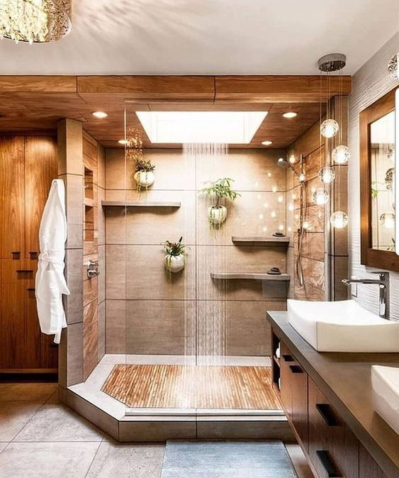 a warm colored spa like shower space done in neutrals and with a rain shower and lights for relaxation
