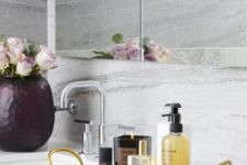 23 a chic and glam bathroom tray of agate and gold handles plus luxurious bath products