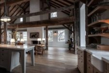24 a cozy barndominium with multiple beams and much stained wood in decor, a white fireplace