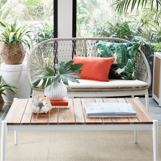 a gorgeous outdoor loveseat of woven rope over a sturdy frame is ideal for a comfortable modern space