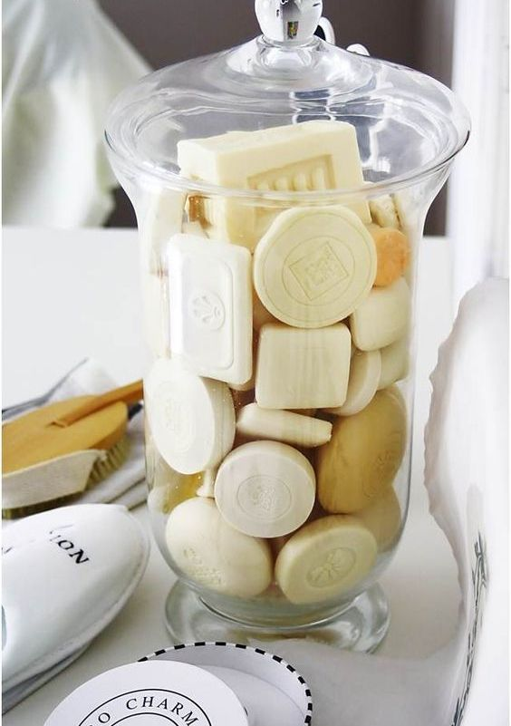 a stylish glass jar with various soaps will instantly raise the level of chic in your bathroom