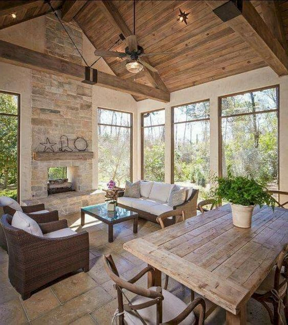 a cozy barndominium space done in neutral colors and all-natural materials, stylish wood and wicker furniture