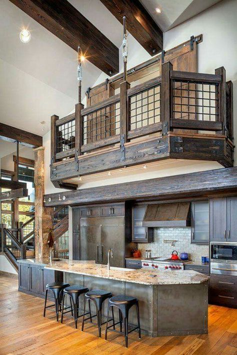 a barndominium with dark stained wood and stone countertops, high ceilings with beams create an airy feeling in the space