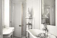 a chic vintage-inspired Parisian bathroom with a tiled floor, a gorgeous whimsy chandelier, a free-standing sink and a statement mirror