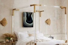 a creative Parisian bedroom with a catchy bed with acrylic framing, a green bench, catchy artworks and blush walls