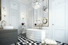a super chic and elegant monochromatic bathroom with a patterned floor, a statement chandelier, a large mirror, a sculptural tub and gilded touches