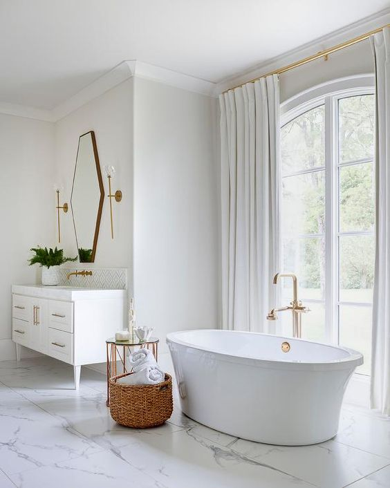 an oval tub, a gorgeous view and a vintage vanity plus a geometric mirror make this transitional space amazing