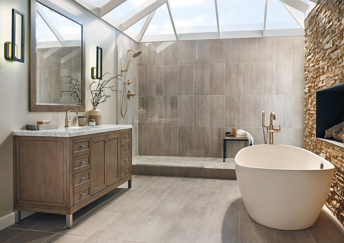wood imitating tiles, faux stone, a vintagw wooden vanity with a stone countertop and a contemporary bathtub for a gorgeous transitional space