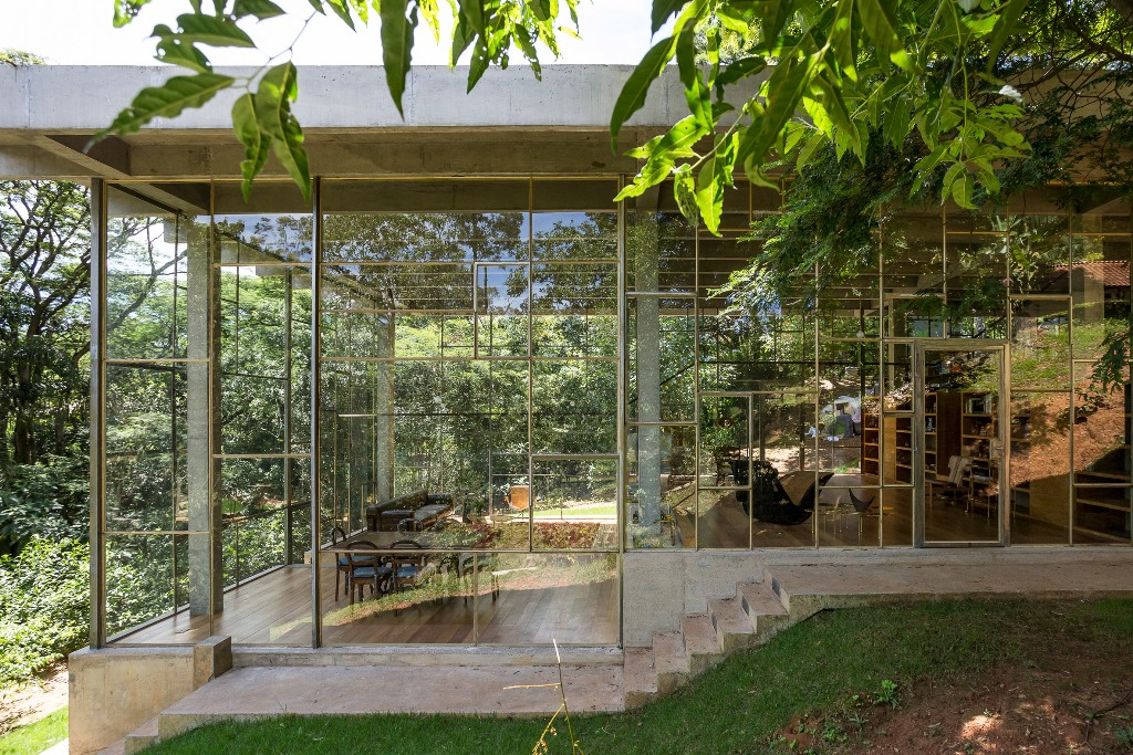This concrete and glass contemporary home is right in the middle of Atlanti Rainforest and it was built for a philosopher to enjoy views and look at the stars