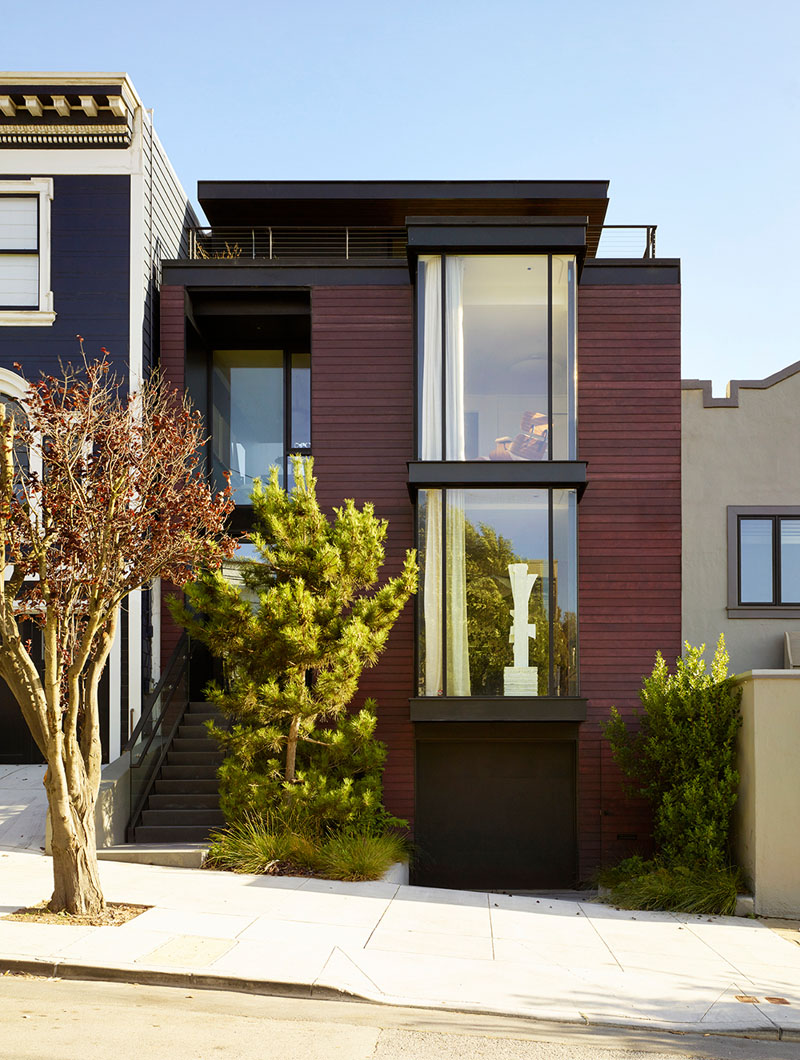 This contemporary home is done with a burgundy facade and features cool contemproary interiors with a character