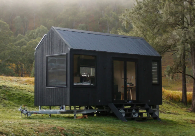 This tiny off grid cabin is great for outdoor living, it's sure to make your summer getaway super sustainable