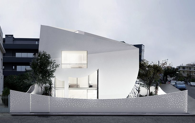 This unique minimalist house in white is filled with light and has a perforated facade, its interior and exterior are both unusual