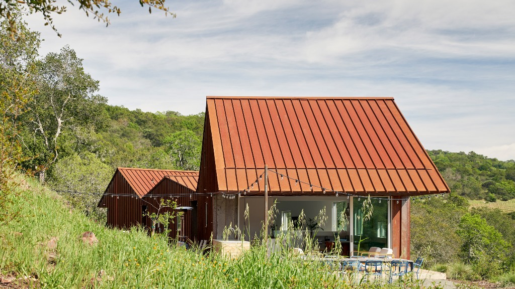 Triple Barn residence is a unique home, which consists of three volumes under gabled roofs that are connected to each other