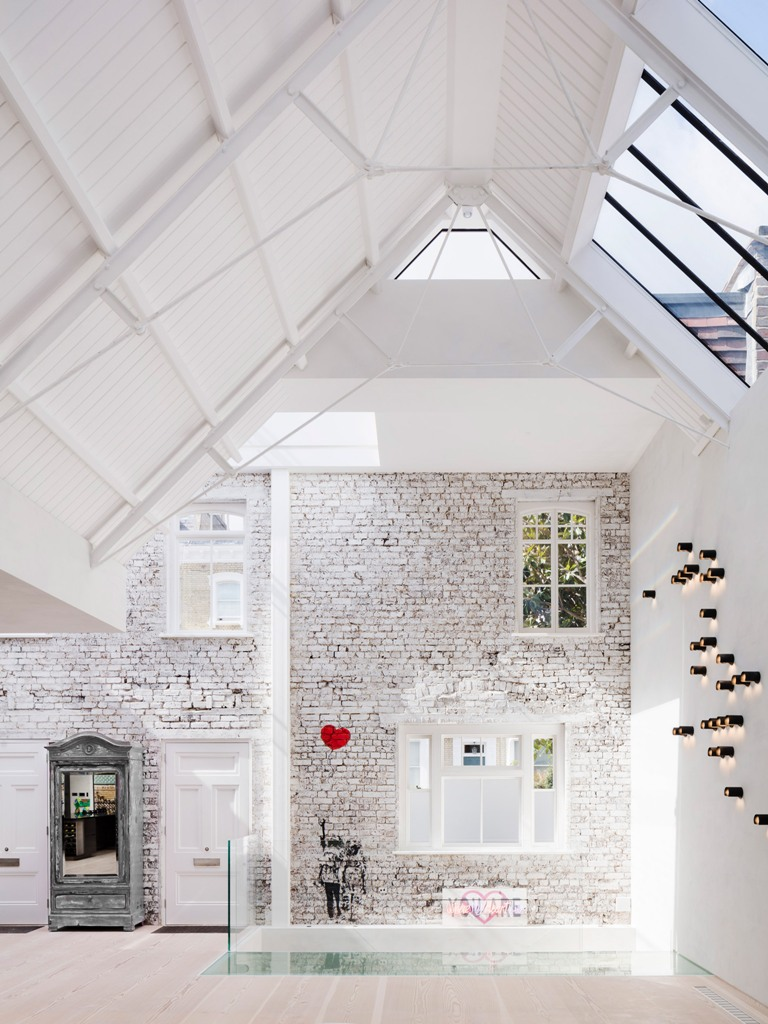 The architects took best of sloped ceilings making skylights, highlighted the brick walls and added art everywhere