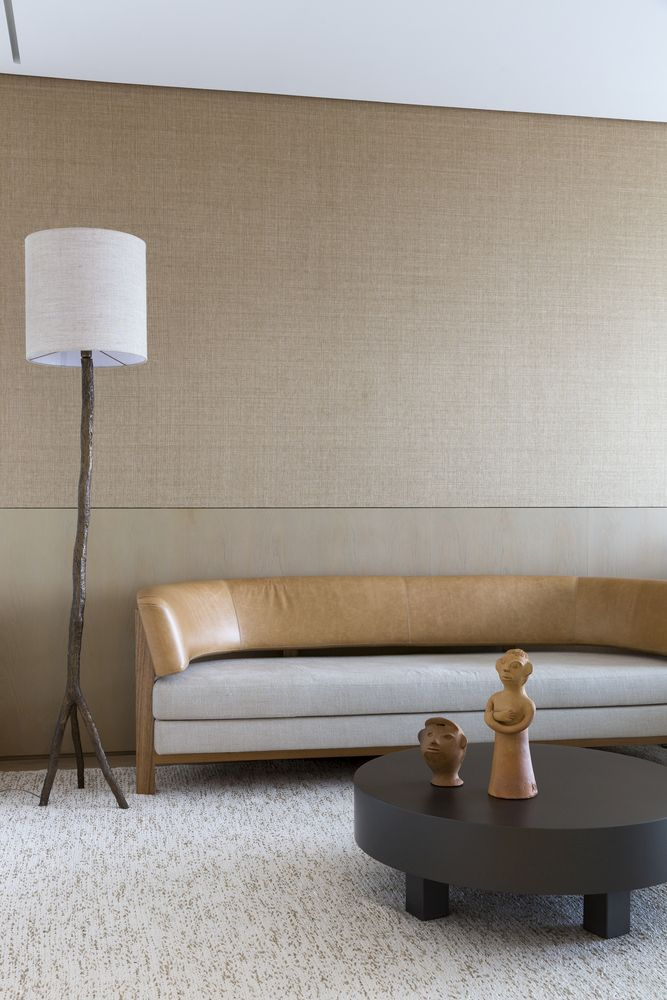 The furniture is contemporary and very elegant, with much texture and unique details like a branch lamp base